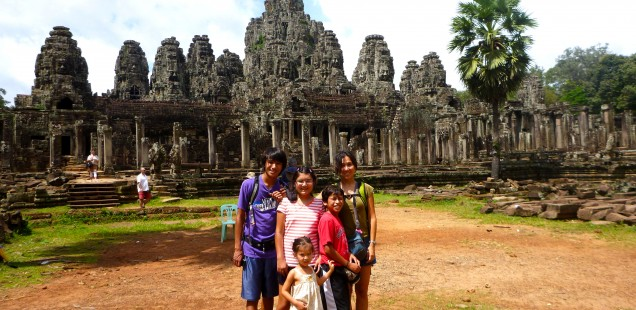 Us at Bayon temple with many stone faces.