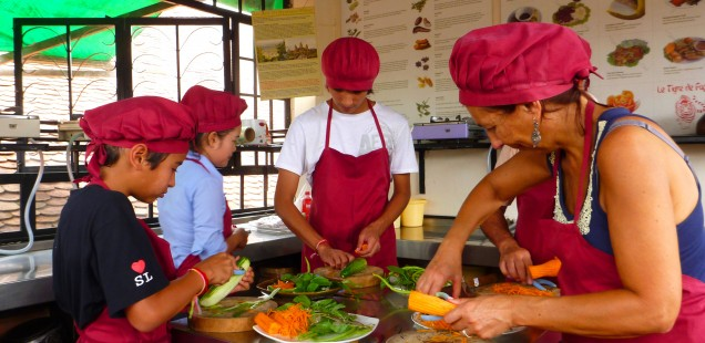 The oldest two enjoying a cooking class in Siam Reap on our rest day.