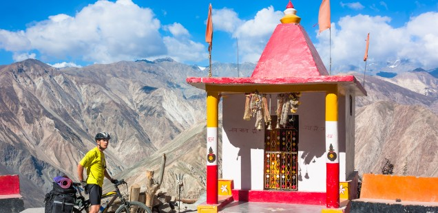 Visiting Tibetan monasteries perched high on rocky crags.